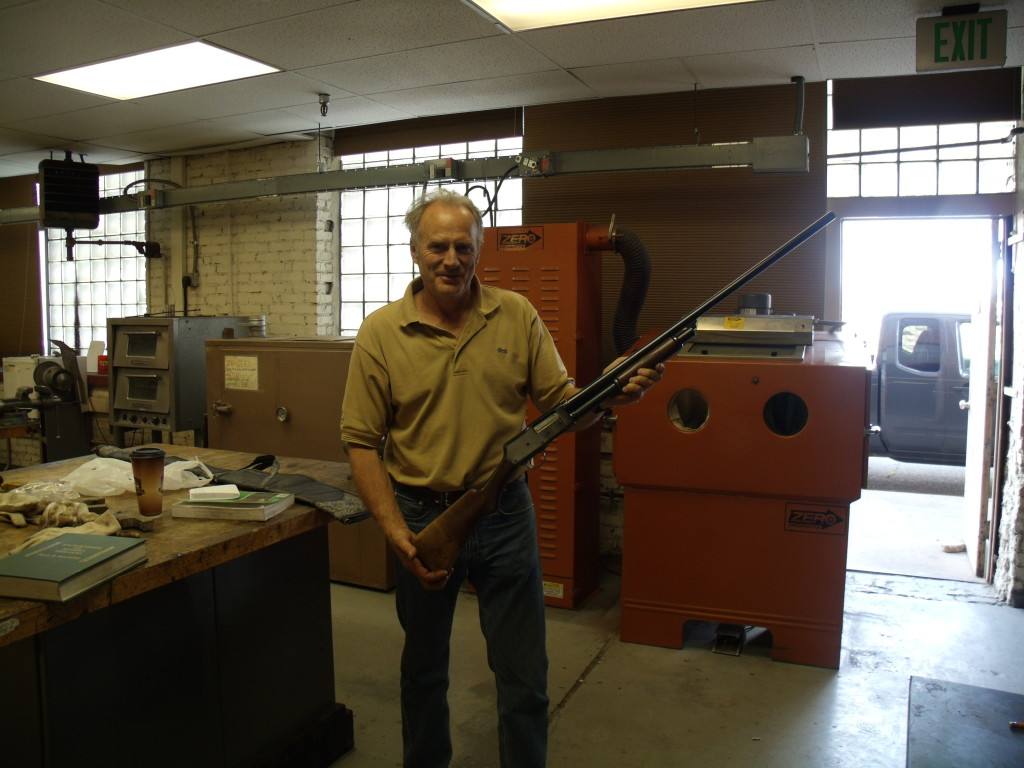 Chuck Grace of the American Gun-Makers Guild admiring my restoration of the Stevens 520
